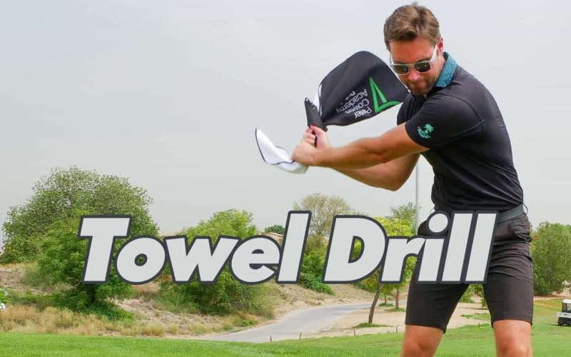 Towel drill to build clubface stability by the Peter Cowen Academy
