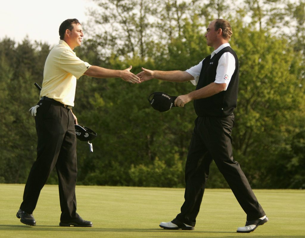 COVENTRY, ENGLAND - MAY 15: Thomas Bjorn of Denmark shakes hands with David Howell of England on the 18th green after winning The Daily Telegraph Dunlop British Masters on the second extra hole after a Three-way play-off against Englishmen Brian Davais and David Howell, at the Forest of Arden Golf Club on May 15, 2005 in Coventry, England. (Photo by Warren Little/Getty Images) *** Local Caption *** Thomas Bjorn;David Howell